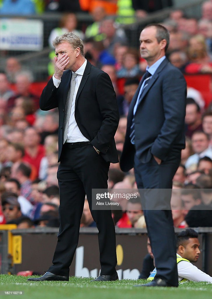 <a gi-track='captionPersonalityLinkClicked' href=/galleries/search?phrase=David+Moyes&family=editorial&specificpeople=215482 ng-click='$event.stopPropagation()'>David Moyes</a> the manager of Manchester United looks on alongside Steve Clarke the manager of West Bromwich Albion during the Barclays Premier League match between Manchester United and West Bromwich Albion at Old Trafford on September 28, 2013 in Manchester, England.