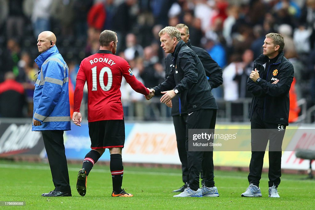 <a gi-track='captionPersonalityLinkClicked' href=/galleries/search?phrase=David+Moyes&family=editorial&specificpeople=215482 ng-click='$event.stopPropagation()'>David Moyes</a> (R) the manager of Manchester United shakes hands with <a gi-track='captionPersonalityLinkClicked' href=/galleries/search?phrase=Wayne+Rooney&family=editorial&specificpeople=157598 ng-click='$event.stopPropagation()'>Wayne Rooney</a> (L) after the final whistle during the Barclays Premier League match between Swansea City and Manchester United at the Liberty Stadium on August 17, 2013 in Swansea, Wales.