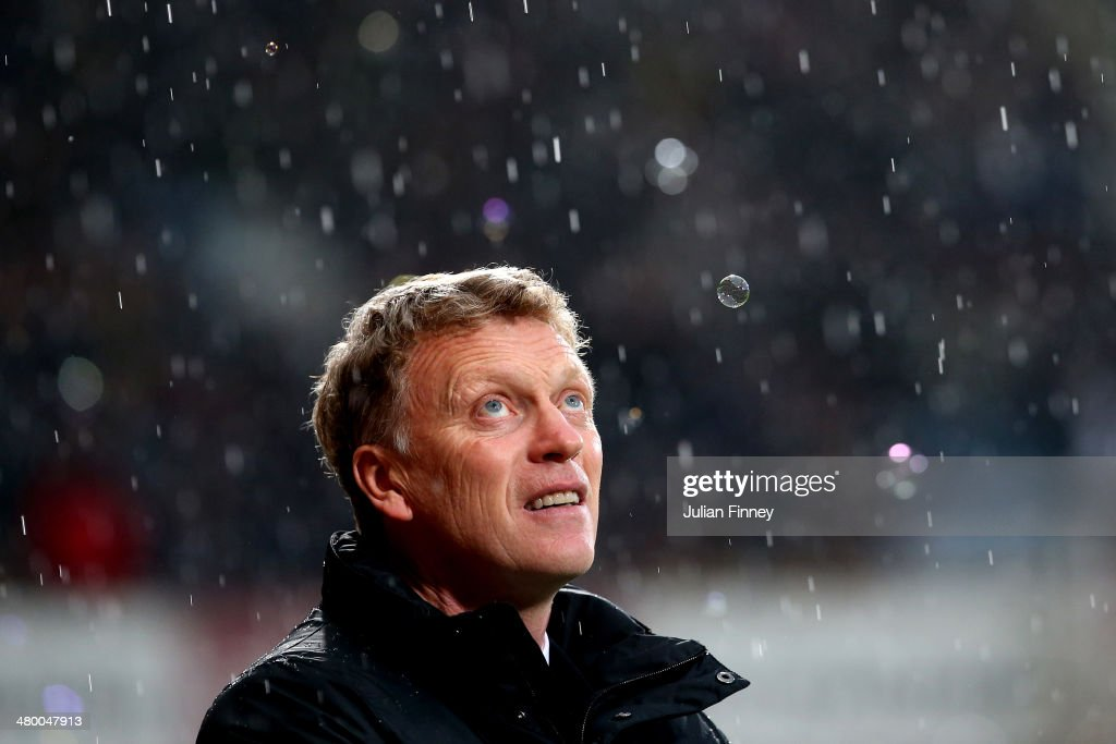 <a gi-track='captionPersonalityLinkClicked' href=/galleries/search?phrase=David+Moyes&family=editorial&specificpeople=215482 ng-click='$event.stopPropagation()'>David Moyes</a> the Manchester United manager looks on prior to kickoff during the Barclays Premier League match between West Ham United and Manchester United at Boleyn Ground on March 22, 2014 in London, England.