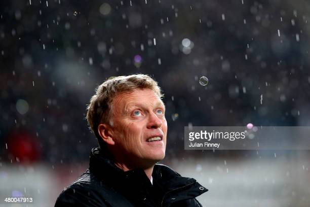 David Moyes the Manchester United manager looks on prior to kickoff during the Barclays Premier League match between West Ham United and Manchester...