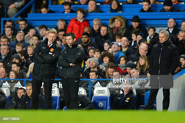 David Moyes the Manchester United manager speaks with the fourth official whilst Jose Mourinho the Chelsea manager looks on during the Barclays...