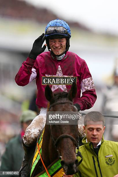 David Mullins celebrates as he enters the Winners' Enclosure after riding Rule The World to victory in the 2016 Crabbie's Grand National at Aintree...