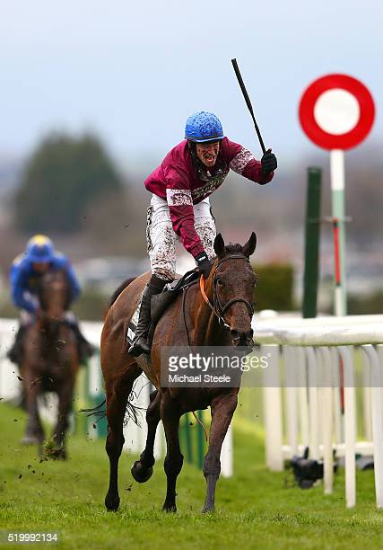 David Mullins celebrates as he rides Rule The World to victory in the 2016 Crabbie's Grand National at Aintree Racecourse on April 9 2016 in...