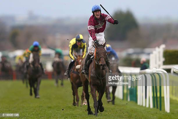David Mullins riding Rule The World celebrates winning the Crabbie's Grand National steeplechase at Aintree Racecourse on April 9 2016 in Liverpool...