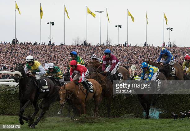 David Mullins riding 'Rule the World' competes in The Grand National Steeple Chase on the final day of the Grand National Festival horse race meeting...