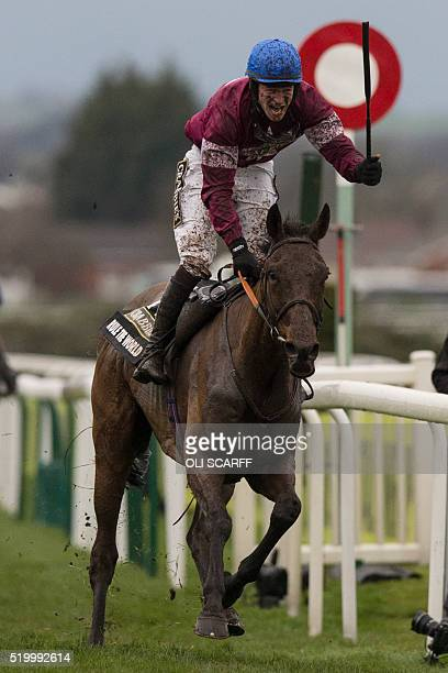 David Mullins riding Rule the World crosses the finish line to win The Crabbie's Grand National Steeple Chase on the final day of the Grand National...