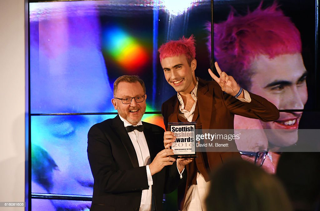 David Mundell MP, Secretary of State for Scotland, and Charles Jeffrey, winner of the Young Designer of the Year award, attend the Scottish Fashion Awards in association with Maserati at Rosewood Hotel on October 21, 2016 in London, England.