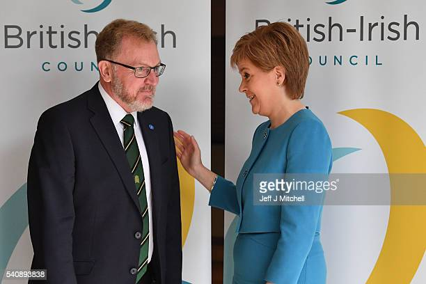 David Mundell Secretary of State for Scotland meets Nicola Sturgeon the First Minister of Scotland as they arrive for the British Irish council on...