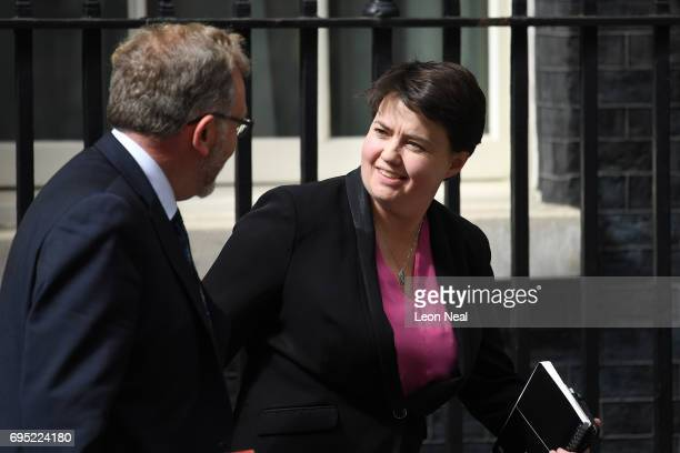 David Mundell UK Scottish secretary and Leader of the Scottish Conservatives Ruth Davidson leave 10 Downing Street on June 12 2017 in London England...