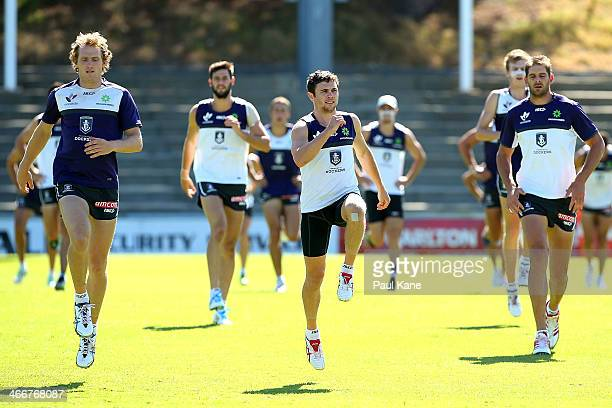 David Mundy Hayden Ballantyne and Aaron Sandilands warm up during a Fremantle Dockers AFL preseason training session at Fremantle Oval on February 4...