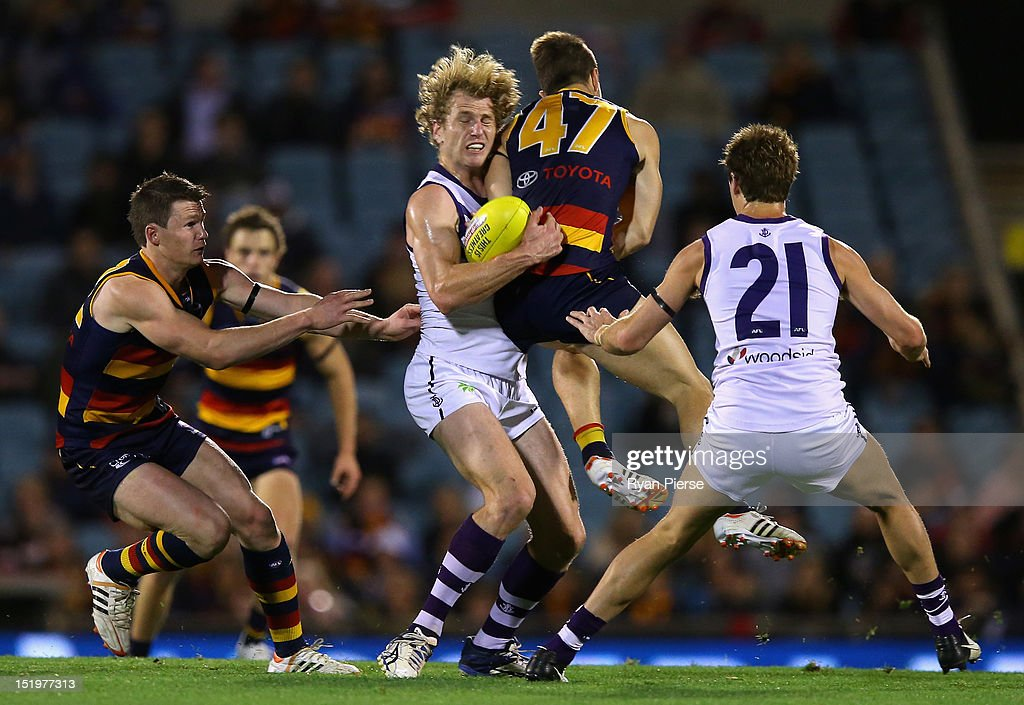 David Mundy of the Dockers clashes with Matthew Wright of the Crows during the AFL Second Semi Final match between the Adelaide Crows and the Fremantle Dockers at AAMI Stadium on September 14, 2012 in Adelaide, Australia.
