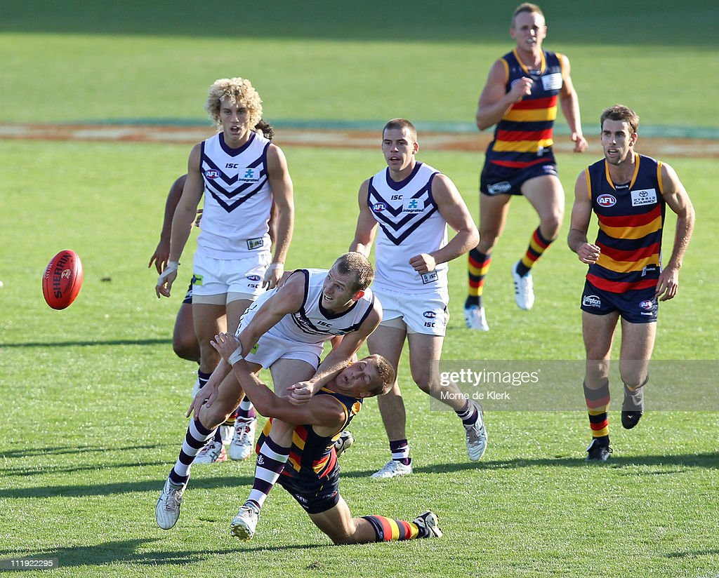 David Mundy of the Dockers gets a pass away while beaing tackled by Brodie Martin of the Crows during the round three AFL match between the Adelaide Crows and the Fremantle Dockers at AAMI Stadium on April 9, 2011 in Adelaide, Australia.