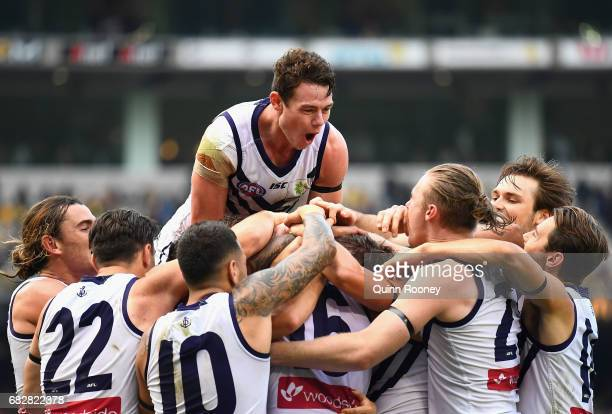 David Mundy of the Dockers is congratulated by team mates after kicking the winning goal during the round eight AFL match between the Richmond Tigers...