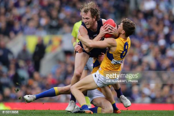 David Mundy of the Dockers is tackled by Jack Redden of the Eagles during the round 17 AFL match between the Fremantle Dockers and the West Coast...