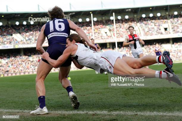 David Mundy of the Dockers is tackled by Jack Steele of the Saints during the round 15 AFL match between the Fremantle Dockers and the St Kilda...