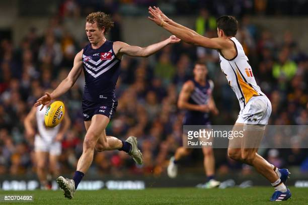 David Mundy of the Dockers passes the ball during the round 18 AFL match between the Fremantle Dockers and the Hawthorn Hawks at Domain Stadium on...