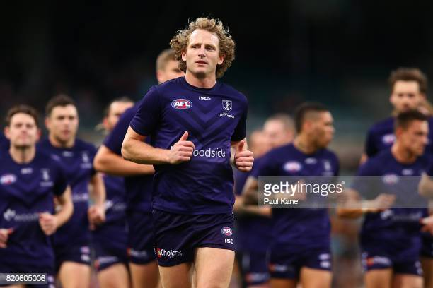 David Mundy of the Dockers runs in from warms ups during the round 18 AFL match between the Fremantle Dockers and the Hawthorn Hawks at Domain...