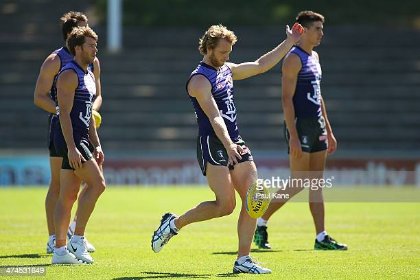 David Mundy passes the ball during a Fremantle Dockers AFL training session at Fremantle Oval on February 24 2014 in Fremantle Australia