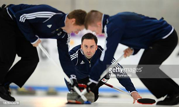 David Murdoch throws a stone during a training session after being selected for the Team GB Curling team for the Sochi 2014 Winter Olympic Games at...
