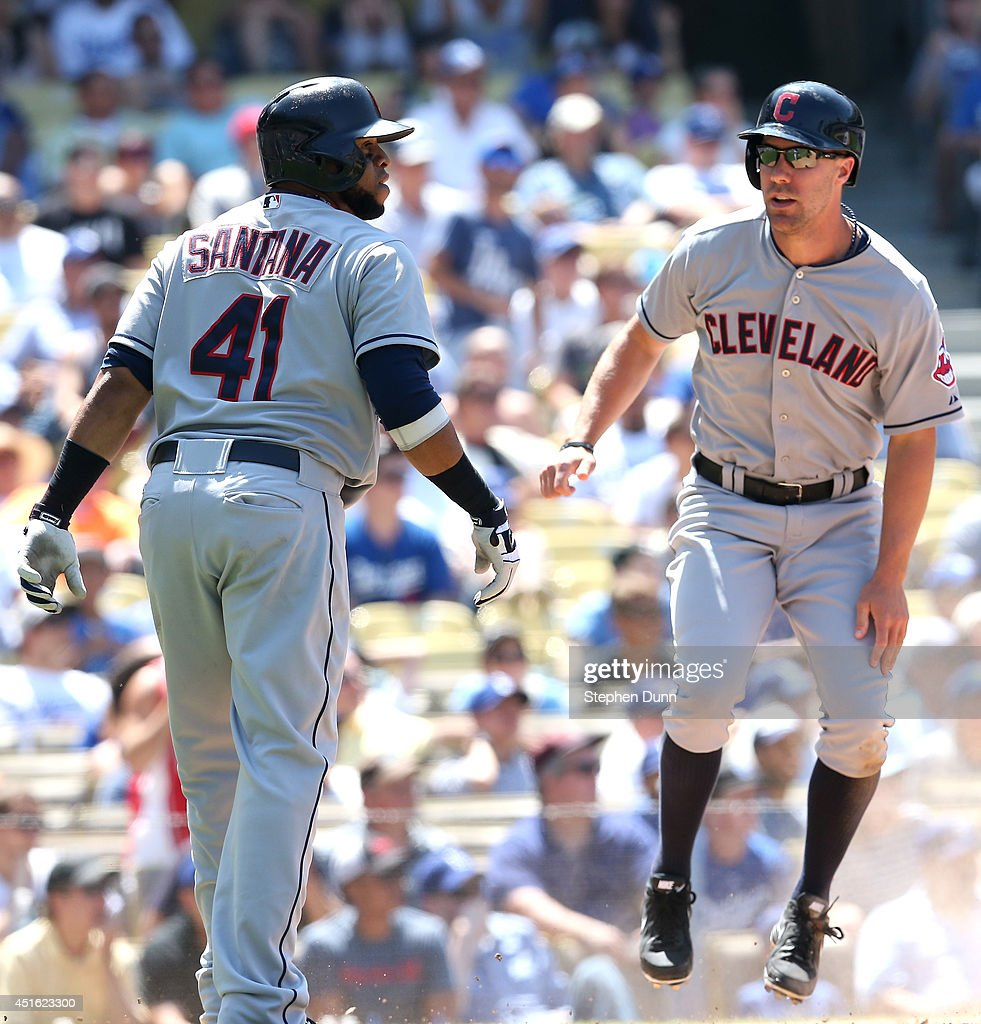 David Murphy #7 and Carlos Santana #41 of the Cleveland Indians react after both score on a tow run single by Mike Aviles to give the Indians the lead over the Los Angeles Dodgers to score a run in the eighth inning at Dodger Stadium on July 2, 2014 in Los Angeles, California. The Indians won 5-4.