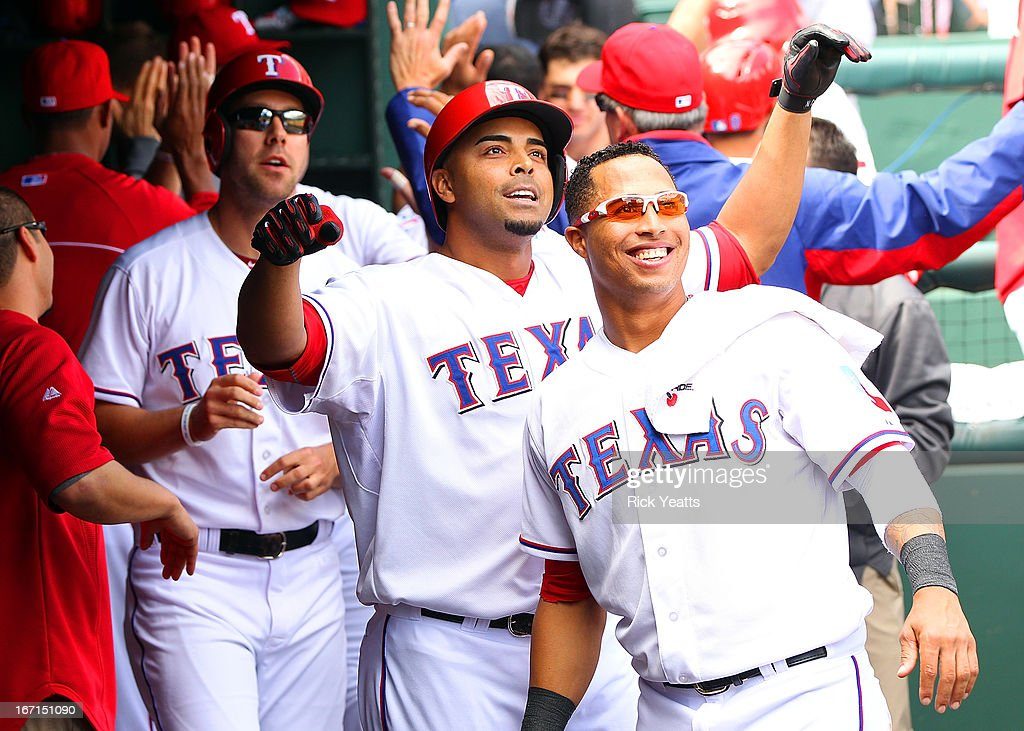 David Murphy #7, Nelson Cruz #17and Leonys Martin #2 of the Texas Rangers watch the video board of Cruz's grand slam home run in the fifth inning against the Seattle Mariners at Rangers Ballpark in Arlington on April 21, 2013 in Arlington, Texas.