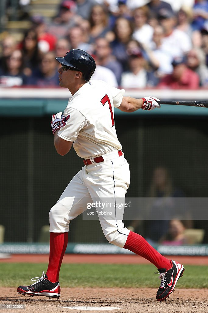 David Murphy #7 of the Cleveland Indians hits a two-run homer to tie the game in the ninth inning against the Texas Rangers at Progressive Field on August 3, 2014 in Cleveland, Ohio.