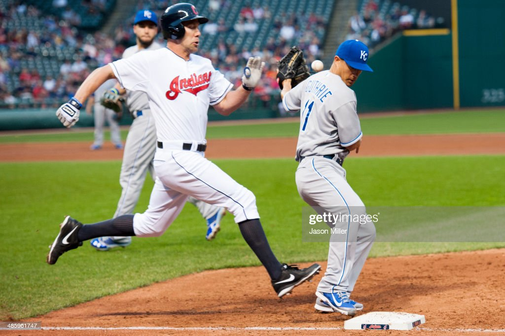 David Murphy #7 of the Cleveland Indians is safe at first as starting pitcher <a gi-track='captionPersonalityLinkClicked' href=/galleries/search?phrase=Jeremy+Guthrie&family=editorial&specificpeople=650221 ng-click='$event.stopPropagation()'>Jeremy Guthrie</a> #11 of the Kansas City Royals drops the ball during the third inning at Progressive Field on April 21, 2014 in Cleveland, Ohio.