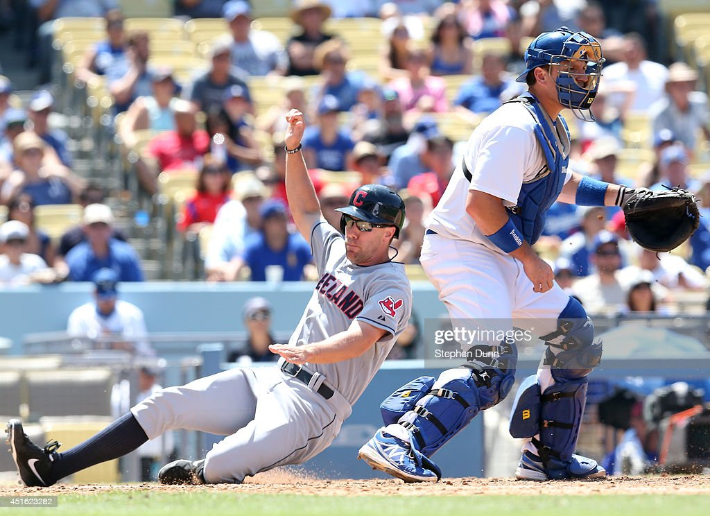 David Murphy #7 of the Cleveland Indians slides past catcher A.J. Ellis #17 of the Los Angeles Dodgers to score a run in the eighth inning at Dodger Stadium on July 2, 2014 in Los Angeles, California. The Indians won 5-4.