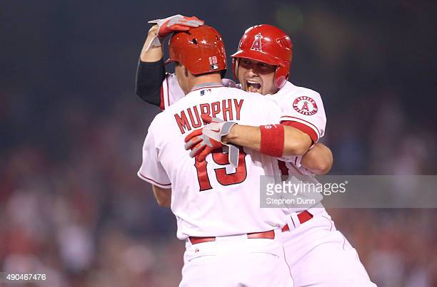 David Murphy of the Los Angeles Angels of Anaheim celebrates with Shane Victorino after his walk off RBI single in the ninth inning against the...