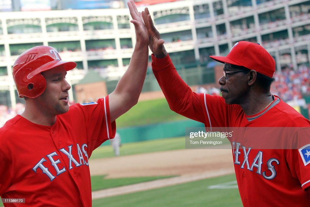 David Murphy #7 of the Texas Rangers celebrates with <a gi-track='captionPersonalityLinkClicked' href=/galleries/search?phrase=Ron+Washington&family=editorial&specificpeople=225012 ng-click='$event.stopPropagation()'>Ron Washington</a> Manager of the Texas Rangers after Hamilton hit the game winning RBI double in the bottom of the eighth inning against the Boston Red Sox on Opening Day at Rangers Ballpark in Arlington on April 1, 2011 in Arlington, Texas.