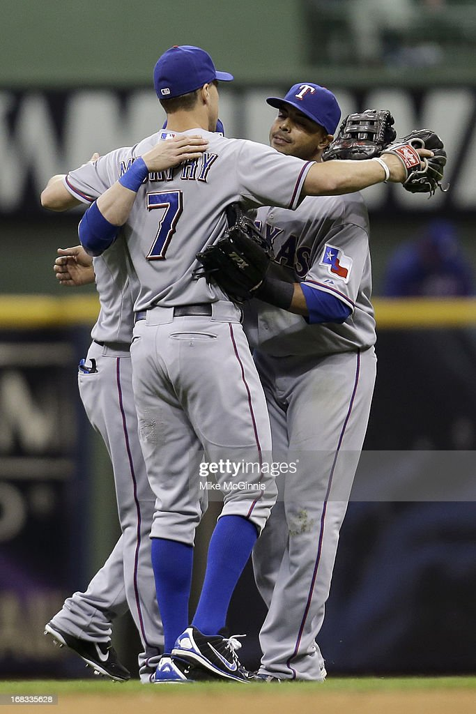 David Murphy #7 of the Texas Rangers clebrates with <a gi-track='captionPersonalityLinkClicked' href=/galleries/search?phrase=Nelson+Cruz&family=editorial&specificpeople=235459 ng-click='$event.stopPropagation()'>Nelson Cruz</a> #17 and Leonys Martin #2 in the outfield after the 4-1 win over the Milwaukee Brewers at Miller Park on May 08, 2013 in Milwaukee, Wisconsin.