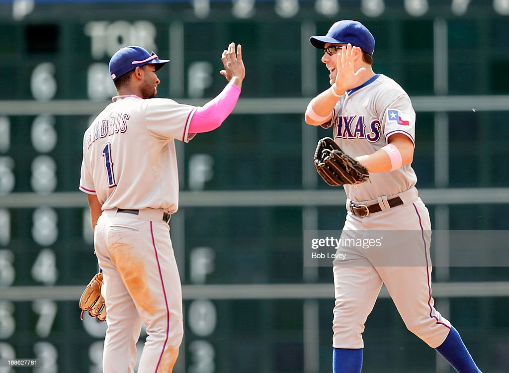 David Murphy #7 of the Texas Rangers high fives <a gi-track='captionPersonalityLinkClicked' href=/galleries/search?phrase=Elvis+Andrus&family=editorial&specificpeople=4845974 ng-click='$event.stopPropagation()'>Elvis Andrus</a> #1 of the Texas Rangers after defeating the Houston Astros at Minute Maid Park on May 12, 2013 in Houston, Texas.