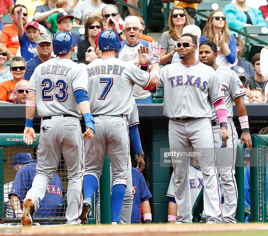 David Murphy #7 of the Texas Rangers is congrartulated by <a gi-track='captionPersonalityLinkClicked' href=/galleries/search?phrase=Nelson+Cruz&family=editorial&specificpeople=235459 ng-click='$event.stopPropagation()'>Nelson Cruz</a> #17 of the Texas Rangers after hitting a home run against the Houston Astros in the third inning at Minute Maid Park on May 12, 2013 in Houston, Texas.