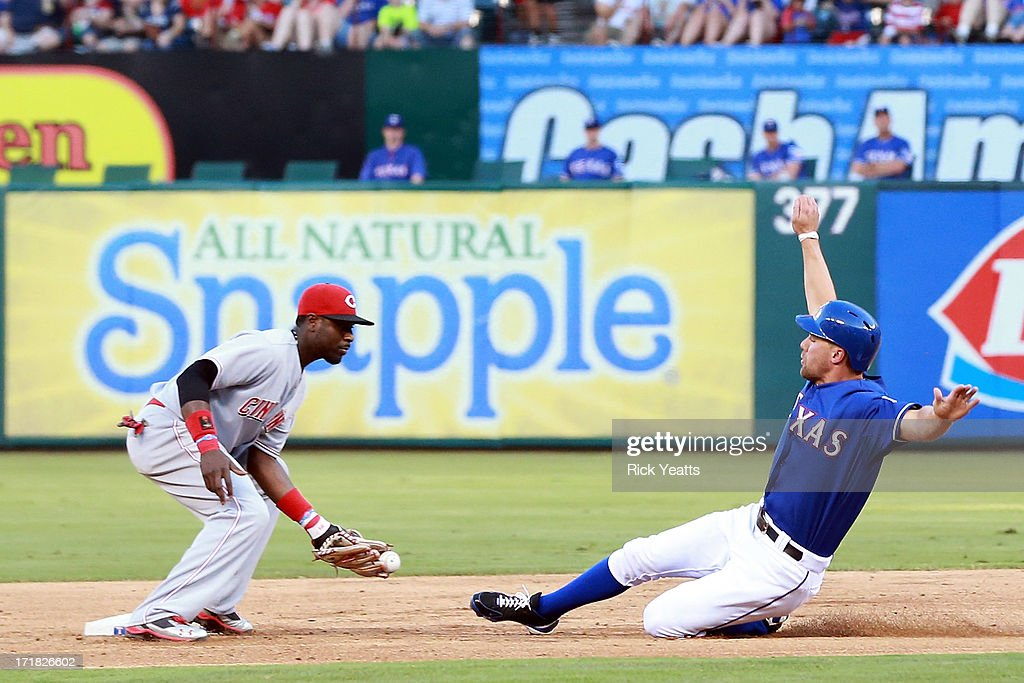David Murphy #7 of the Texas Rangers steals second base in the second inning against Brandon Phillips #4 of the Cincinnati Reds at Rangers Ballpark in Arlington on June 28, 2013 in Arlington, Texas.