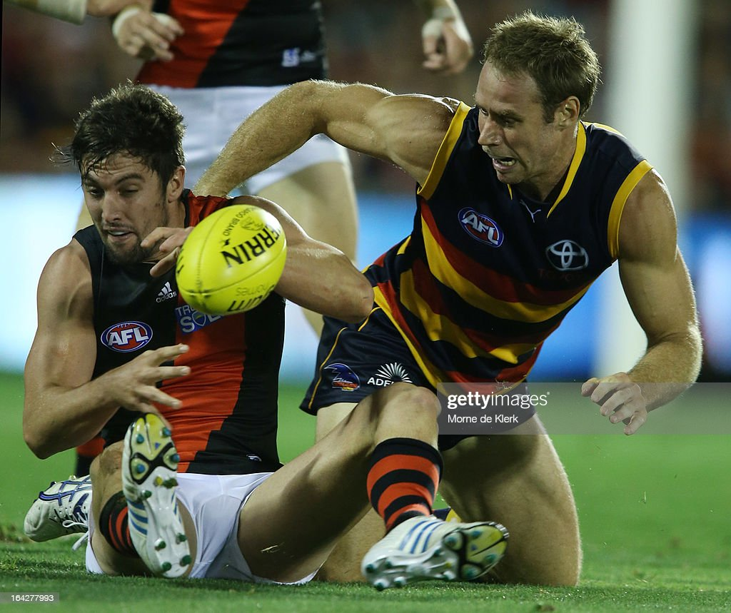 David Myers of the Bombers and <a gi-track='captionPersonalityLinkClicked' href=/galleries/search?phrase=Ben+Rutten&family=editorial&specificpeople=234363 ng-click='$event.stopPropagation()'>Ben Rutten</a> of the Crows compete on the ground during the round one AFL match between the Adelaide Crows and the Essendon Bombers at AAMI Stadium on March 22, 2013 in Adelaide, Australia.