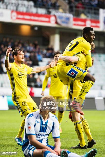 David Myrestam of GIF Sundsvall celebrates with Peter Wilson and teammates after scoring the opening 01 goal and Thomas Rogne of IFK Goteborg is...