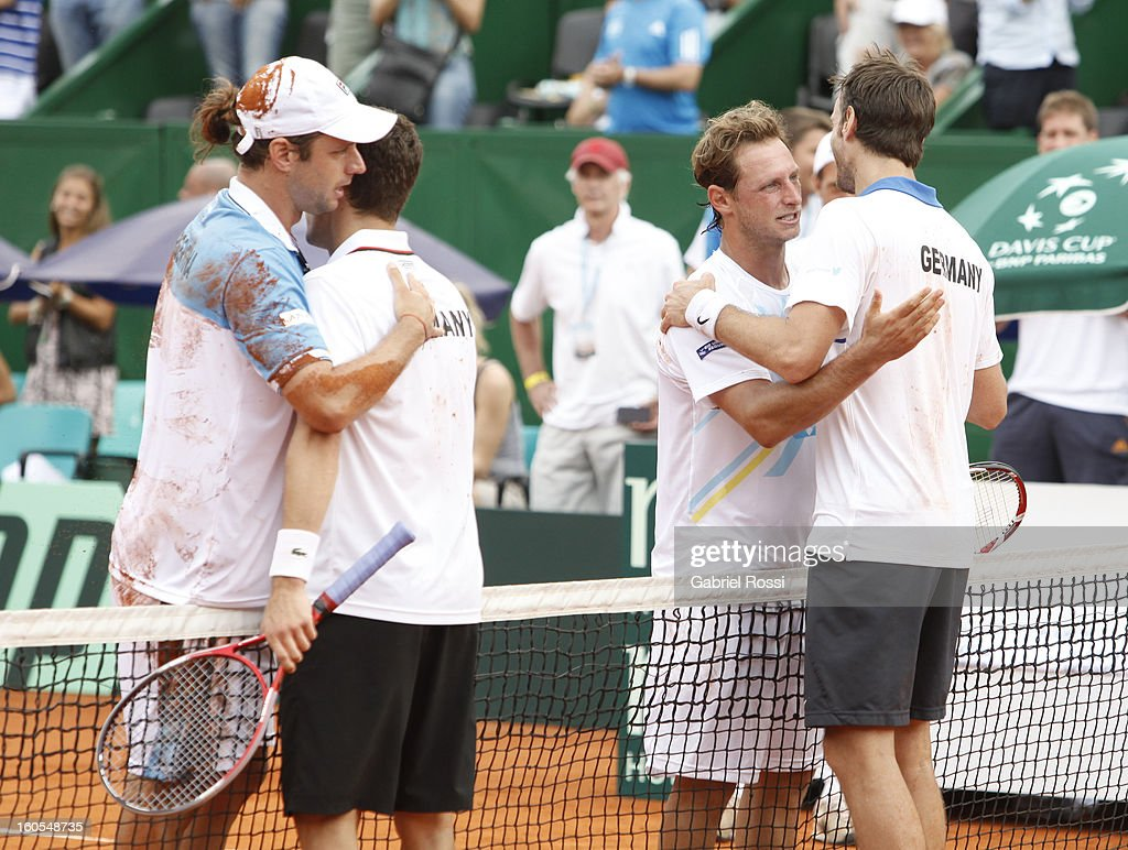 David Nalbandian and Horacio Zeballos of Argentina greet Christopher Kas and Tobias Kamke of Germany after a match on the second day of Davis Cup at...