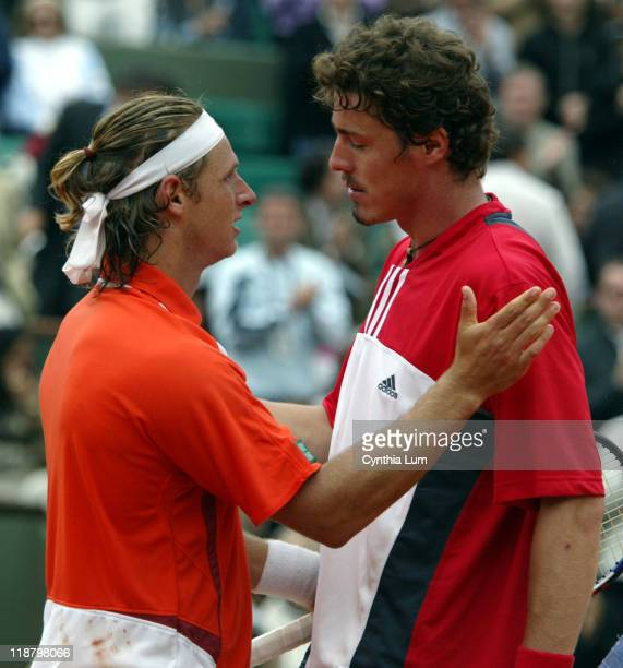 David Nalbandian and Marat Safin shake hands after Nalbandian won their 4th round match 75 64 67 63 with Safin suffering from badly blistered hands