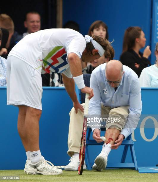 David Nalbandian of Argentina apologies but is disqualified after injuring line judge Andrew McDougall's leg during his men's singles Final match...
