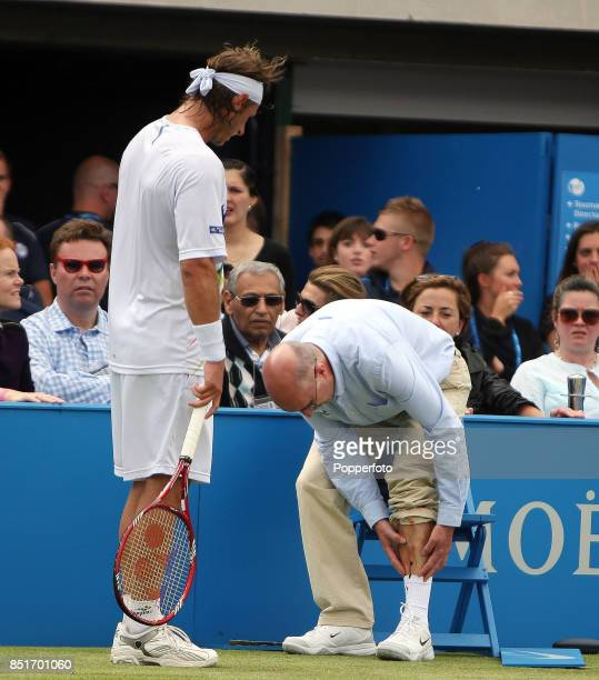 David Nalbandian of Argentina is disqualified after injuring line judge Andrew McDougall's leg during his men's singles Final match against Marin...