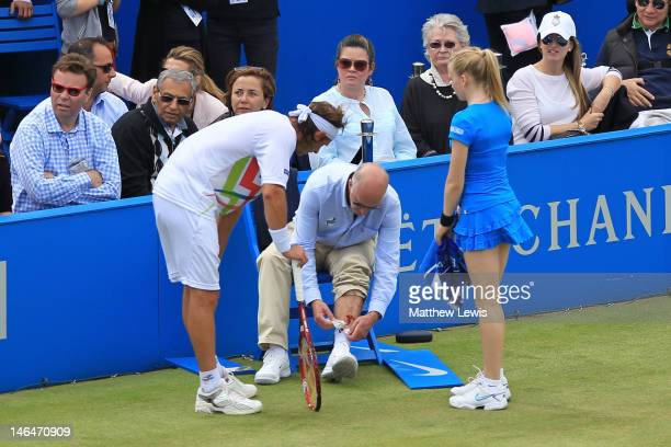 David Nalbandian of Argentina looks on as he injures a Line Judge's leg during his mens singles final round match against Marin Cilic of Croatia on...