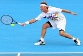 David Nalbandian of Argentina plays a forehand during his exhibition match against Andy Murray of Great Britian during day three of the 2012 Kooyong...