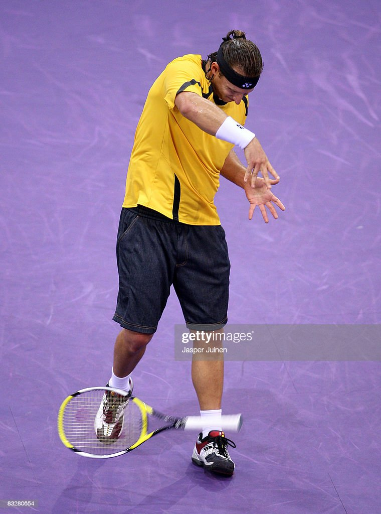 David Nalbandian of Argentina smashes his racket in anger after loosing the tiebreak of the second set during his second round Madrid Masters tennis...