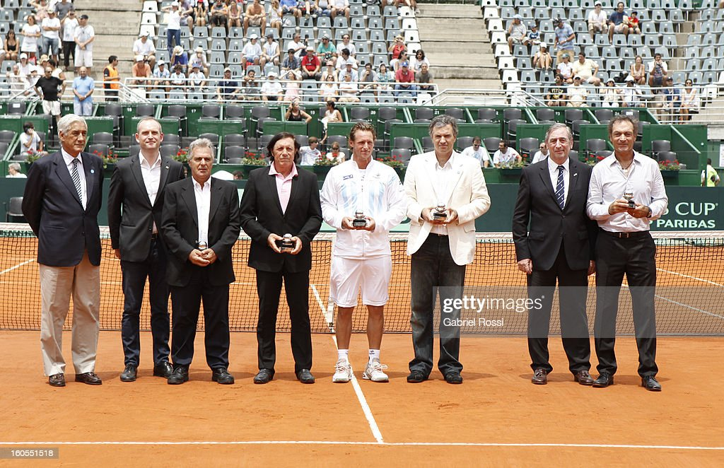 <a gi-track='captionPersonalityLinkClicked' href=/galleries/search?phrase=David+Nalbandian&family=editorial&specificpeople=171323 ng-click='$event.stopPropagation()'>David Nalbandian</a> poses next to <a gi-track='captionPersonalityLinkClicked' href=/galleries/search?phrase=Guillermo+Vilas&family=editorial&specificpeople=605489 ng-click='$event.stopPropagation()'>Guillermo Vilas</a>of Argentina after the match against Christopher Kas and Tobias Kamke (not in frame) of Germany on the second day of Davis Cup at Parque Roca Stadium on February 02, 2013 in Buenos Aires, Argentina.