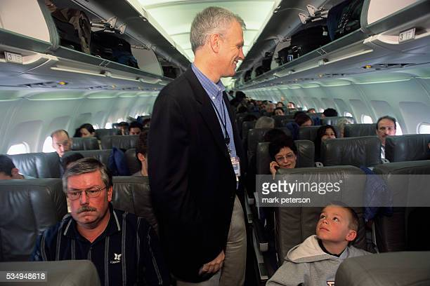 David Neeleman CEO of JetBlue Airways talks with passengers in the cabin of a plane at John F Kennedy International Airport JetBlue Airways was...