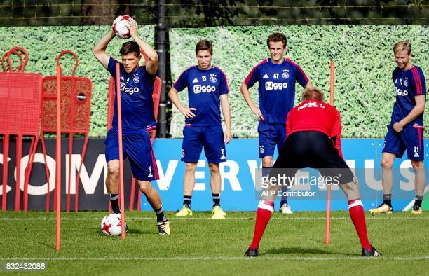 David Neres and Davinson Sanchez of Ajax take part in a training session in Amsterdam on August 16 in preparation of the first playoff match of the...