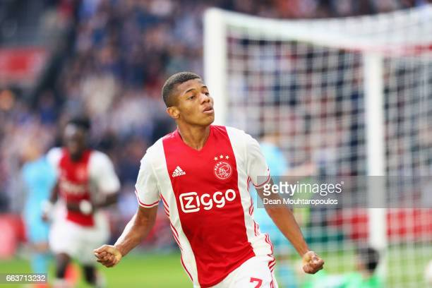 David Neres of Ajax celebrates scoring his teams second goal of the game during the Dutch Eredivisie match between Ajax Amsterdam and Feyenoord at...