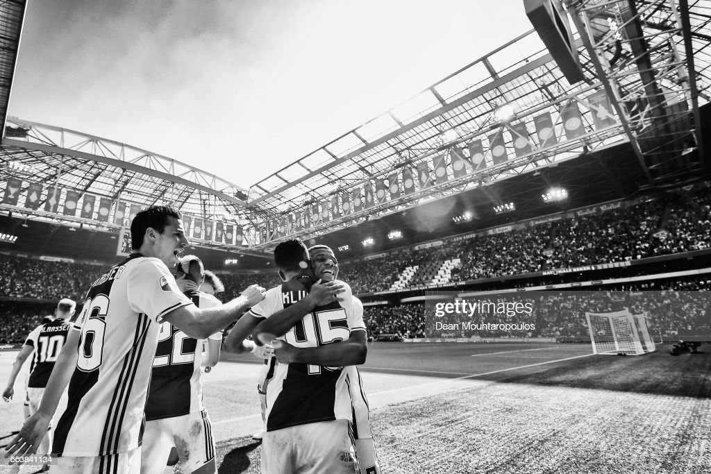 David Neres of Ajax celebrates scoring his teams second goal of the game with team mates Nick Viergever and Justin Kluivert during the Dutch Eredivisie match between Ajax Amsterdam and Feyenoord at Amsterdam ArenA on April 2, 2017 in Amsterdam, Netherlands.