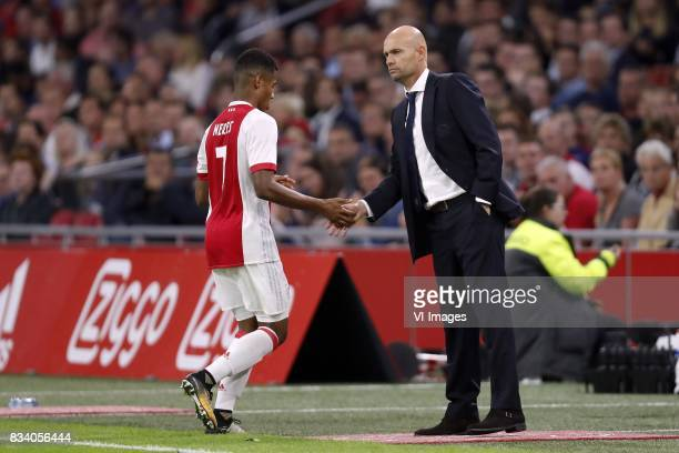 David Neres of Ajax coach Marcel Keizer of Ajax during the UEFA Europa League fourth round qualifying first leg match between Ajax Amsterdam and...