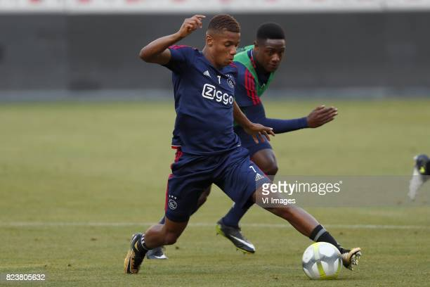 David Neres of Ajax Deyovaisio Zeefuik of Ajax during a training session prior to the third round qualifying first leg match between OGC Nice and...